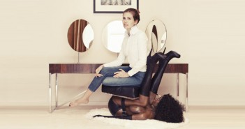 Magazine-feature-photo-of-a-white-woman-sitting-on-a-black-woman-mannequin-chair-disgrace-to-the-industry